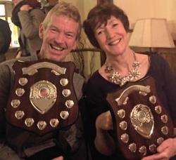 Forres Harriers club champions Douglas Cowie and Anne Docherty with their awards.
