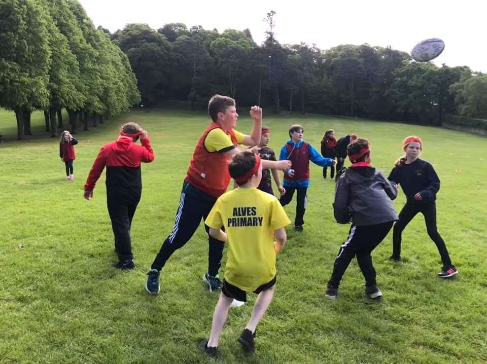 Pupils from Alves, Dallas, Dyke, Kinloss and Logie taking part in a summer rugby festival at Grant Park.