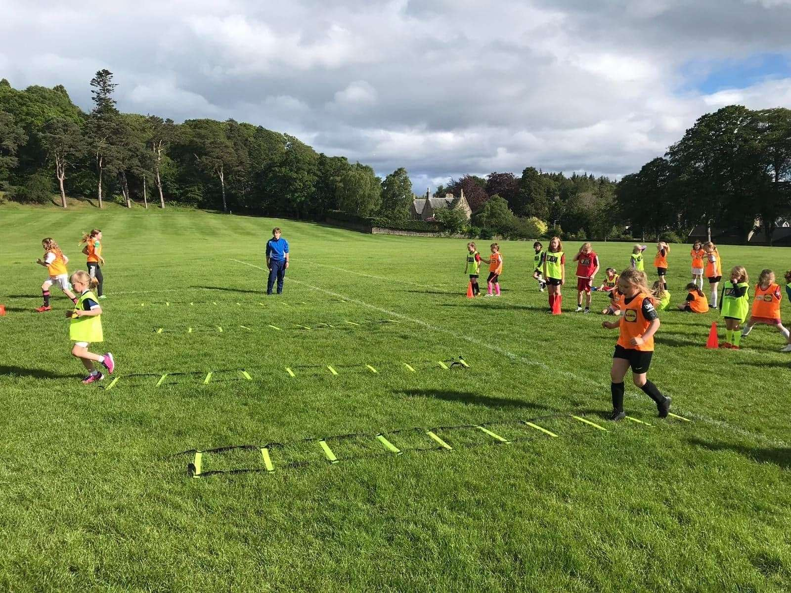 Forres Girls Football Club coach Denise Simpson passing on her knowledge at Grant Park.