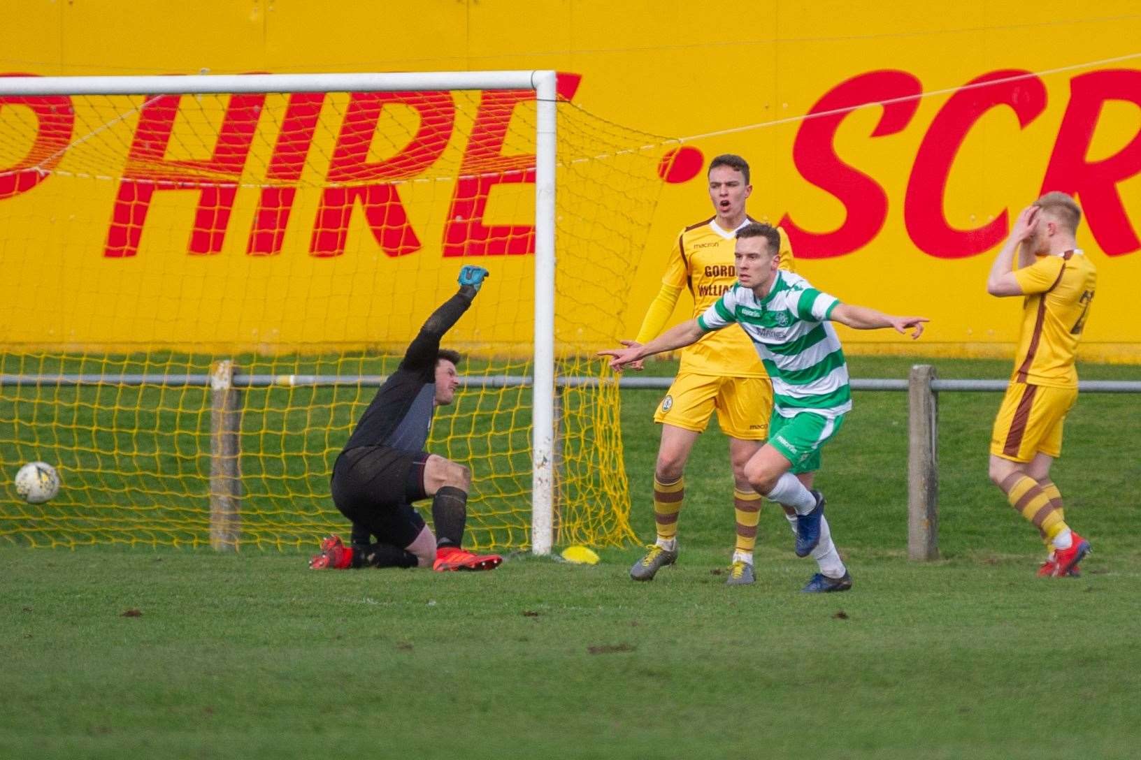 Buckie Thistle's Scott Adams celebrates the Jags equaliser much to the annoyance of the Forres back line. Picture: Daniel Forsyth