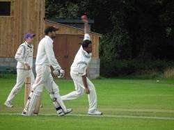 Dhami watches on as Mandal bowls