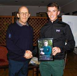 Club Captain Albert Duffus presents Jeff Wright with a picture marking him becoming the 2013 North District SGU Matchplay Champion